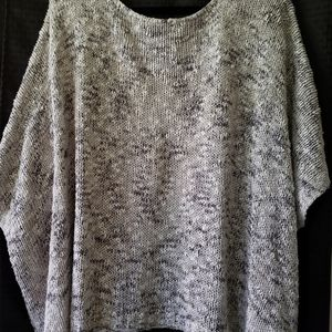 Knit oversize top with front pockets .